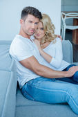 Middle Age Lovers on Couch Looking at Camera — Stock Photo