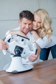 Sweet Young Couple Having Fun with Cool Gadget — Stock Photo