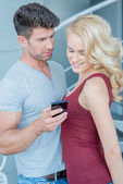Young Caucasian Lovers Looking at Phone — Stock Photo