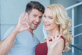 Laughing happy couple making Perfect gestures — Stock Photo