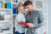 Sweet Partners Reading at Mini Library — Stock Photo