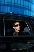 Serious Woman in Shades Inside Expensive Car — Стоковое фото