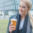 Young woman enjoying coffee on a cold day — Stock Photo #56097539