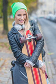 Pretty Woman in Trendy Attire Embracing Skateboard — Stock Photo