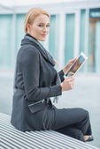 Corporate Woman Holding Tablet Outside Office — Stock Photo