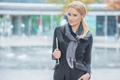 Blond Woman in Fashionable Black Office Attire — Stock Photo
