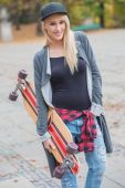 Cool Pretty Woman Holding Skateboard — Stock Photo
