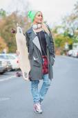 Pretty Woman in Cool Casual Attire with Skateboard — Stock Photo
