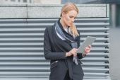 Attractive woman using a tablet outdoors — Stock Photo
