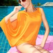 Smiling Pretty Woman in Orange Summer Outfit — Stock Photo #56193281