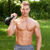 Gorgeous Topless Fit Man Carrying Weights Outdoor — Stock Photo