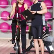 Woman working out with a fitness instructor — Stockfoto #56427203