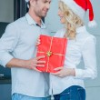 Romantic young couple celebrating Christmas — Stock Photo #56836451