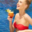 Laughing woman enjoying a tropical cocktail — Stock Photo #57094011