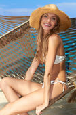 Sexy slender woman relaxing on a hammock — Stock fotografie