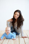 Mother and Baby on Floor Looking at Camera — Stock Photo
