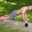 Athletic Young Man Exercising at the Park — Stock Photo #57641907