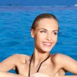 Happy Pretty Woman at the Edge of Swimming Pool — Stock Photo #57642479
