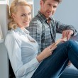 Young Couple Sitting on Floor at Mini Library — Stock Photo #58217015