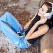 Sitting Happy Woman Listening Music to Headphone — Stock Photo #59306397