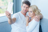 Smiling Young Lovers Taking Self Photos — Stock Photo