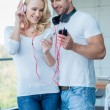 Couple Listening Music from Phone — Стоковое фото #59906913