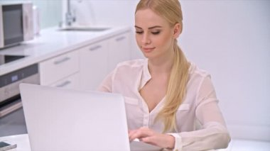 Blond Girl Sitting and Working on Laptop — Vidéo