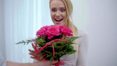 Happy young woman with a bouquet of flowers — Stock Video