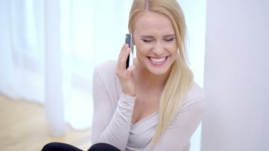Joyful young woman chatting on her mobile — Stock Video
