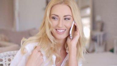 Smiling Blond Female Talking through Phone — Stock Video