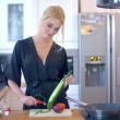 Young woman preparing a healthy salad — Stock Video #65472537
