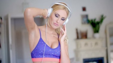 Blissful young woman listening to music — Stock Video