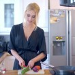 Stylish woman preparing dinner — Stock Video #66165019