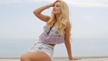Blond Woman Reclining  near Ocean — Stock Video