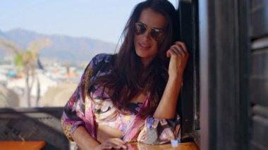 Woman Wearing Sunglasses on Tropical Balcony — ストックビデオ