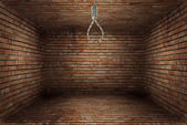 empty room with noose of rope — Stock Photo