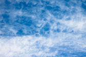 Background of cirrus clouds on a blue sky — Stock Photo