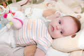 Portrait of adorable smiling newborn baby — Stock Photo