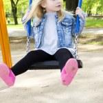 Little girl on outdoor playground equipment — Stock Photo #73828467
