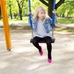 Little girl on outdoor playground equipment — Stock Photo #73828473