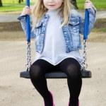 Little girl on outdoor playground equipment — Stock Photo #73828475