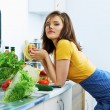 Woman eat in kitchen in cooking time. — Stock Photo #53967007