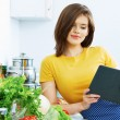 Portrait of young cooking woman in kitchen. — Stock Photo #53968617
