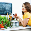 Young woman in kitchen. — Stock Photo #53968659