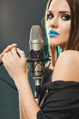 Beautiful woman with microphone. — Stock Photo