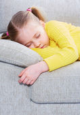 Girl sleep in a casual clothes  on sofa. — Stock Photo