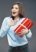 Surprised business woman hold red gift — Foto de Stock