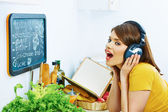 Woman cooking with singing. — Stock Photo