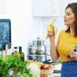 Woman eat in kitchen in cooking time. — Stock Photo #53970279