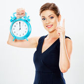 Smiling business woman hold watch — Stock Photo